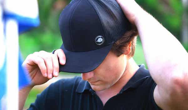 man wearing The Original Cap Magnet on the left hand side