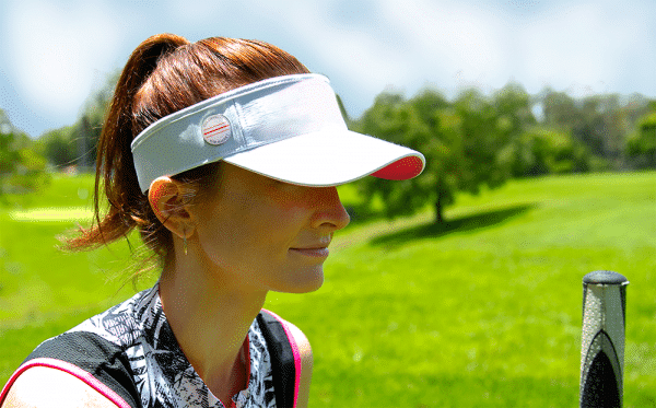 Woman Wearing a Cap Magnet with Directional Ball Markeron White Visor
